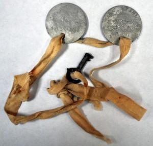 Earl L. Stahl's dog tags